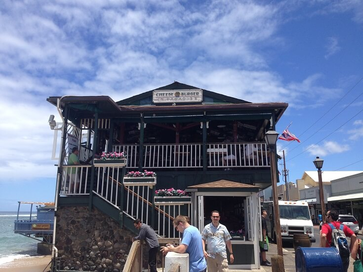 Two story, open air Cheeseburger in Paradise sits directly on Lahaina's beach