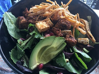 Chicken Coasterra salad with a light pomegranate vinaigrette