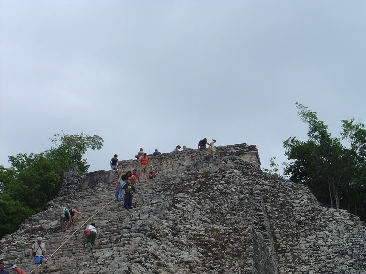 Hikers make their way up the steep side of Coba