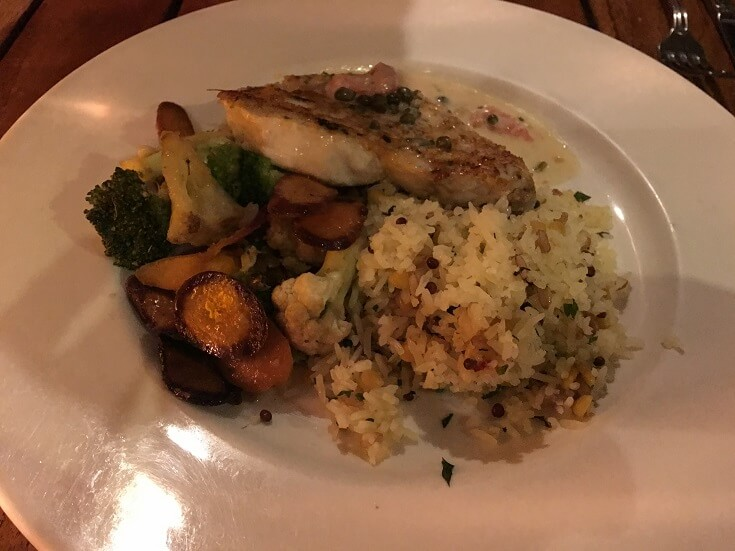 Sweet macadamia nut crusted swordfish with rice and locally grown vegetables