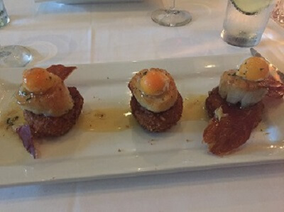 Island Prime's pan roasted Scallops on a risotto cake with prosciutto and butternut squash