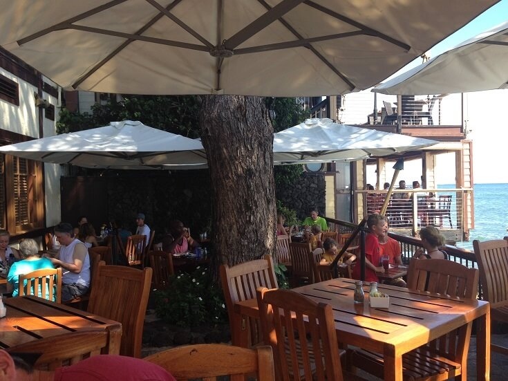 Trees and umbrellas provide the perfect setting at Kimo's outdoor dining area
