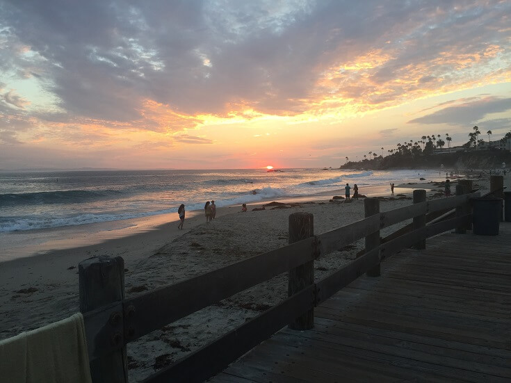 Sun goes down from a Laguna Beach boardwalk