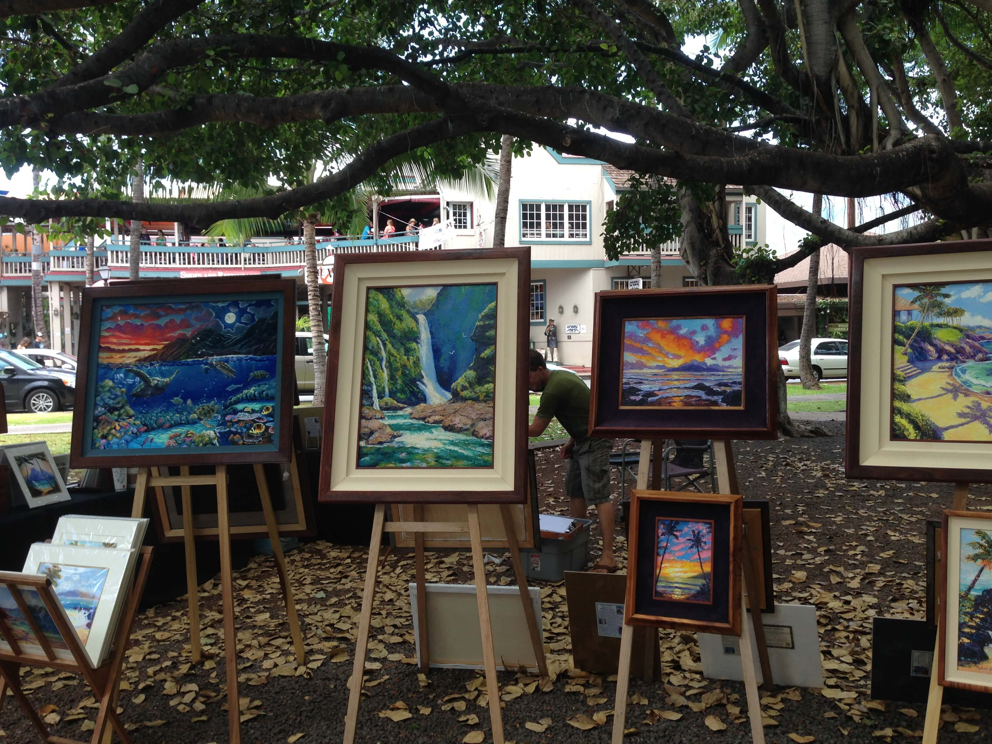 Vendors of local fine art display their items