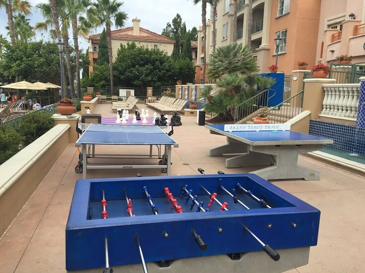 Play ping pong and foosball next to the main pool