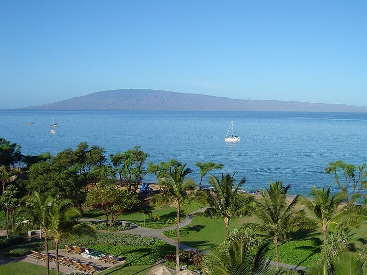 View of Kaanapali Maui and the calm Pacific Ocean from the Westin Ocean Resort Villas