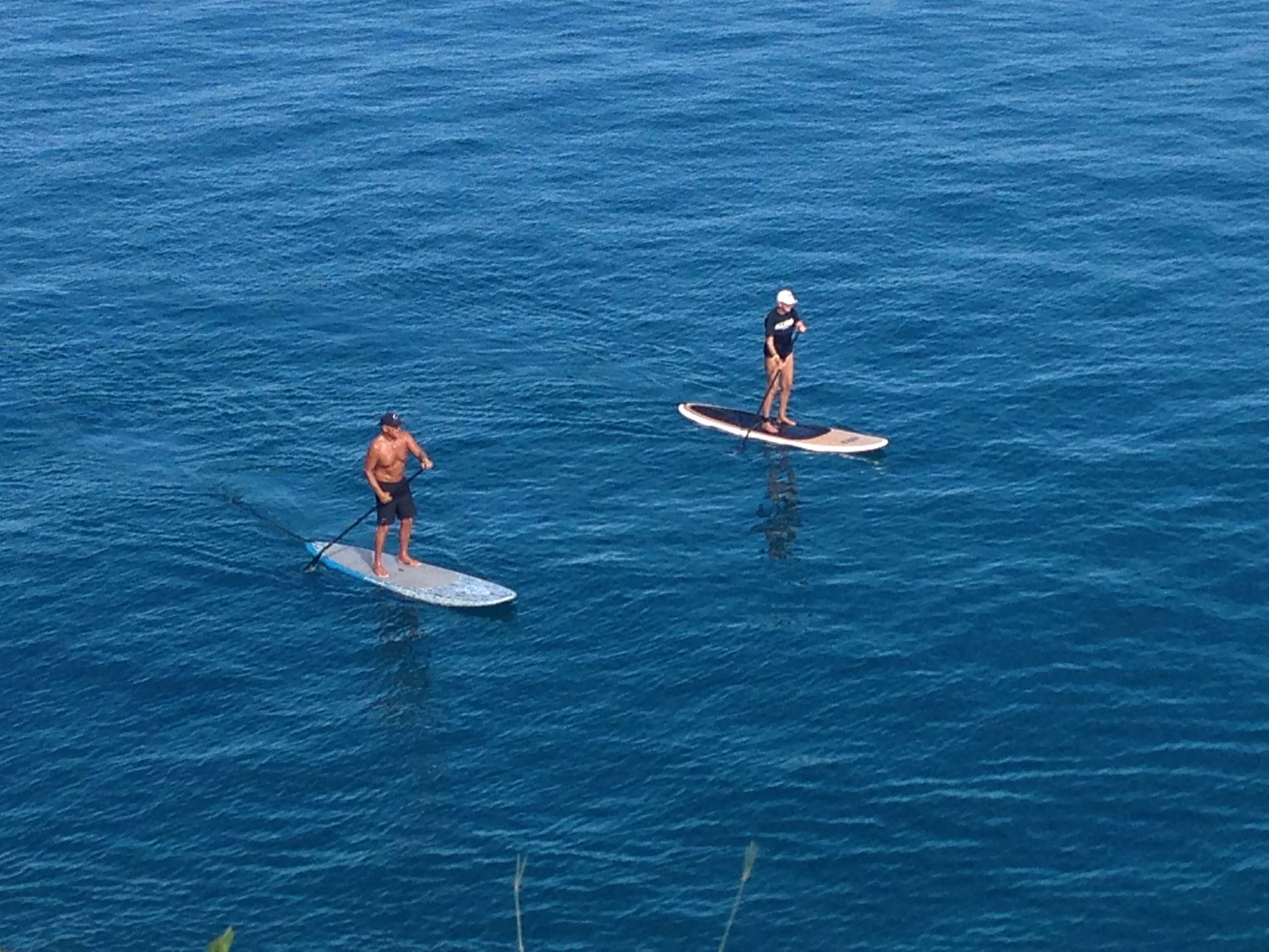 Paddle boarding off the cliffs at Black Rock