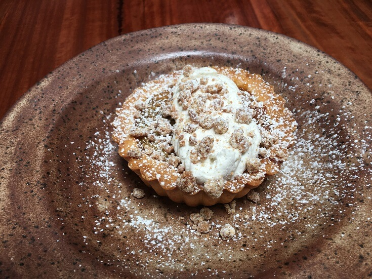 Mill House macadamia nut tart with  light coating of powdered sugar