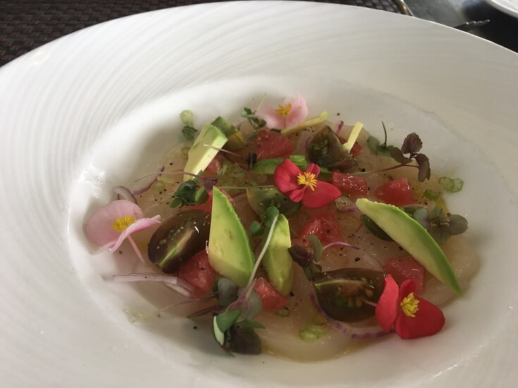 Chef's special, off the menu creation, of scallops, avocados, herbs and locally grown Maui organic vegetables