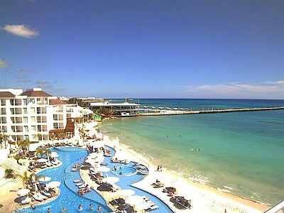 View of the pool and Caribbean at Playacar Palace in Playa del Carmen Mexico