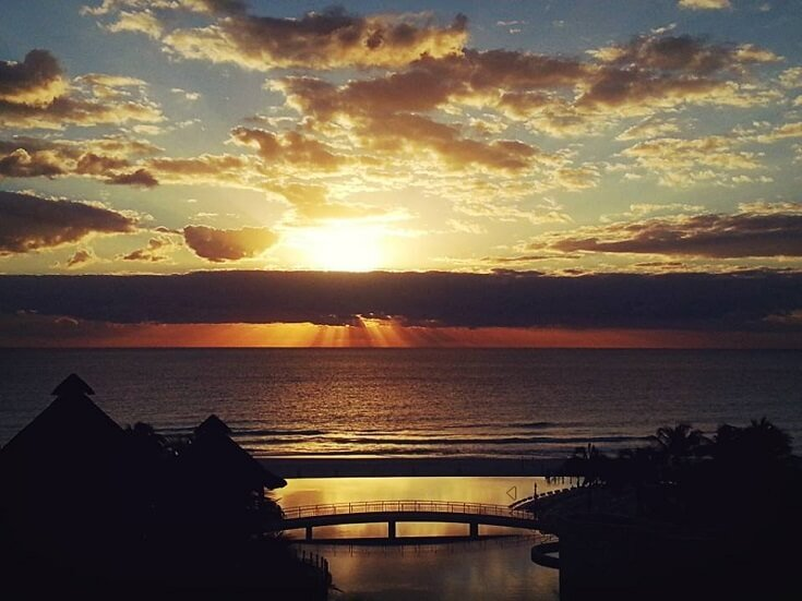 Sun rises over the Caribbean with a view from our resort balcony in Cancun at the Westin Lagunamar Resort and Spa