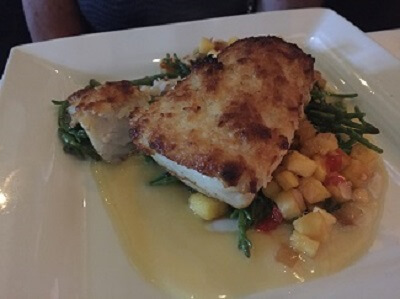 Island Prime's macadamia crusted Seabass with roasted pineapple salsa