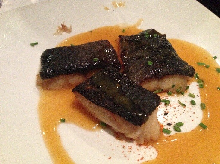 Three perfectly prepared pieces of Sansei butterfish in a sake and sweet miso sauce